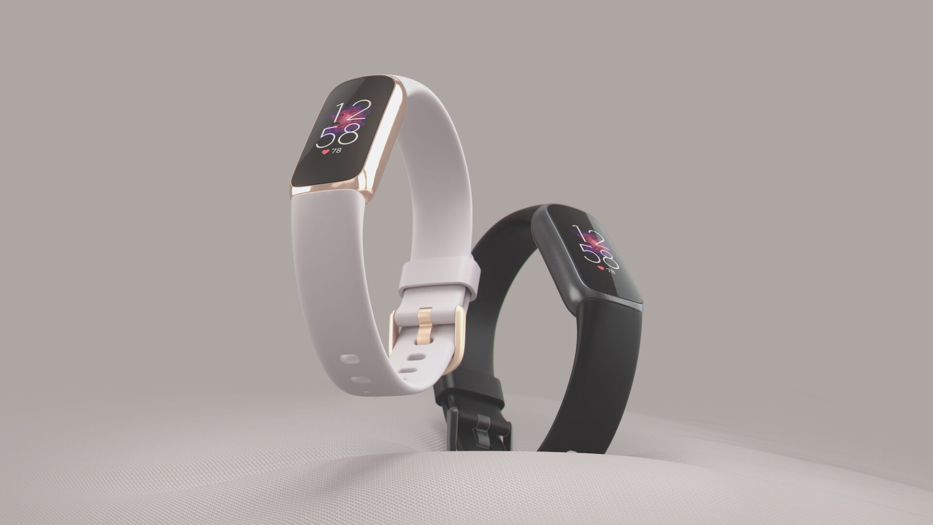Fitbit_Luxe_Laydown_Hero_Duo_Lunar_White_Black_Center